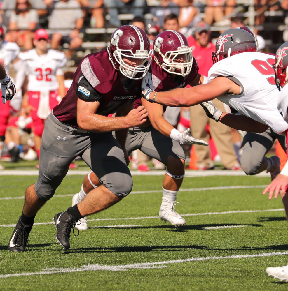 Springfield College offensive lineman and Madison graduate Chris Hayden makes a block in a game earlier this season. The Pride led all of Division III football in rushing this year.