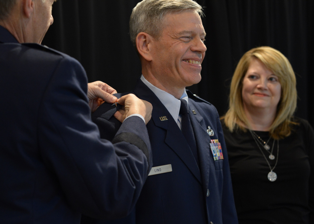 Brig. Gen. Douglas A. Farnham, adjutant general of the Maine Air National Guard, left, pins brigadier general rank onto Eric W. Lind, center, at a Dec. 1 ceremony in Augusta. Lind's wife, Sandra, right, participated in the promotion ceremony. Lind was named the assistant adjutant general of the Maine Air National Guard.