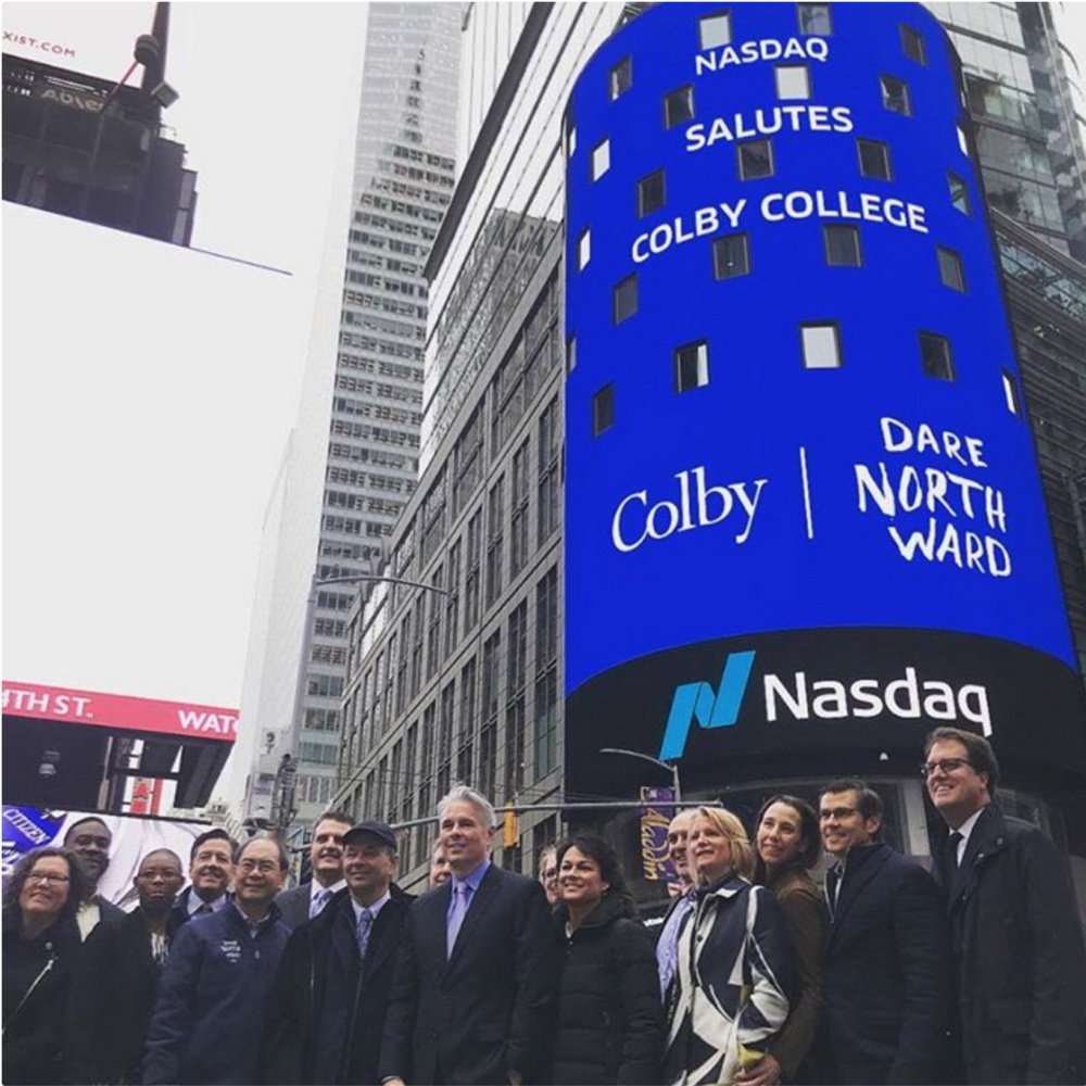 Thanks to a college trustee, Colby College leaders were invited to the Nasdaq stock exchange to witness the opening bell of Wednesday's session. Logos of Colby and Dare Northward, the name of the college's capital campaign, were projected on the Naasdaq sign in Times Square.