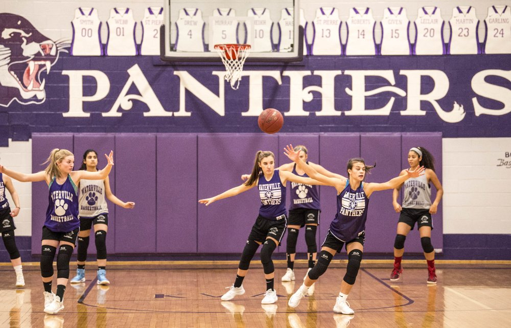 Members of the Waterville girls basketball team practice Thursday at the school.