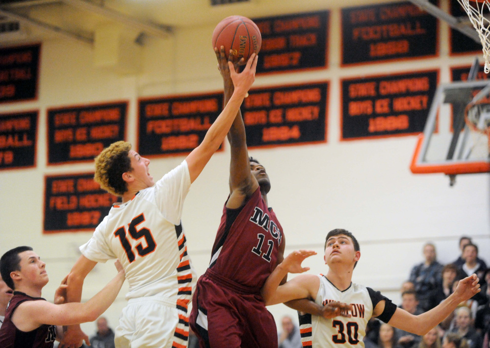 Not so fast: Winslow's Jack Morneault (15) tries to block a shot from Maine Central Institute's Pedro Matos during a Class B game last season in Winslow.