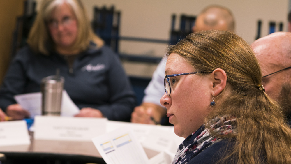 Sarah Bolduc-Ignasiak, left, a parent and member of the Future of the T.C. Hamlin Committee, listens in November to a discussion about options regarding the school now that enrollment has dropped to 44 students.