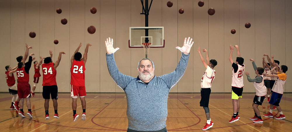 Cony High School boys basketball coach T.J. Maines puts an emphasis on three-point shots during the season.