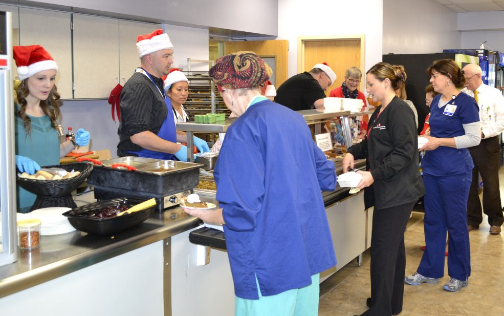 "The fourth annual Meal for a Meal took place Dec. 6 in the Franklin Memorial Hospital cafeteria. A full holiday meal for diners was offered by the cafeteria for a donation for the Franklin County Chamber of Commerce's Gerry Wiles Holiday Food Basket Program. The program distributes holiday food baskets to residents from Rangeley, Eustis, Carthage, Livermore and all points in between that meet federal eligibility guidelines for food insecurity. The event raised $1,721, which will provide 68 meal baskets for the program. Behind the counter, from left, are Katie Drouin, Scott Foster, Mary Grignon, Greg O'Donal and Shannon Smith, chamber member. For more information, call 779-2555 or visit <a href=""http://www.fchn.org"">www.fchn.org</a>."