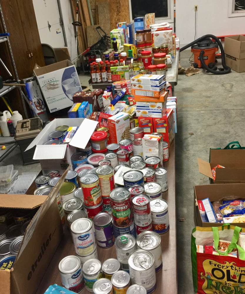 Richmond-area residents donated 1,280 food items at the town's tree-lighting ceremony Friday, after Quincy Emmons, 7, and Brady Alexander, 11, sent out word they were hoping to collect food for those who need help this Christmas.