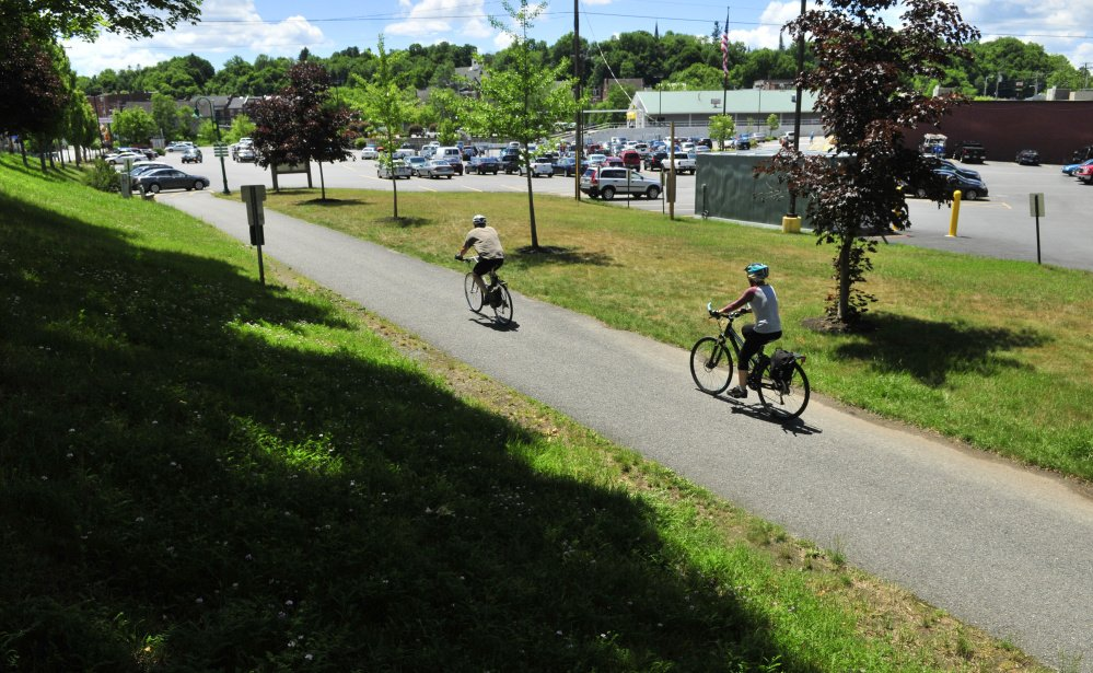 Bicyclists reach the end of the Kennebec River Rail Trail in the Hannaford parking lot in Gardiner in June 2016. There are plans to lengthen Gardiner's trail system by adding a stretch along Cobbossee stream, and city officials will review the latest designs for the proposed trail at a meeting Wednesday.