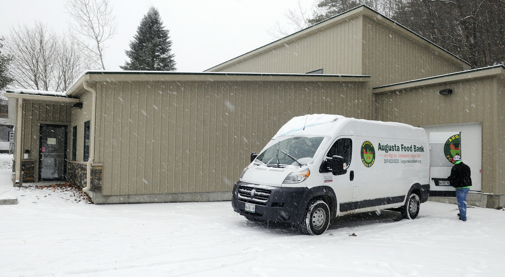 Warehouse manager Andy Waller closes a door of the Augusta Food Bank van Tuesday outside the new Augusta Food Bank in Augusta. He was moving food from the group's old warehouse to this new one.