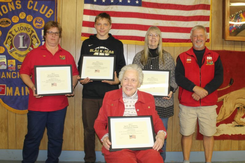 The Manchester Lions recently presented its Youth, Adult, Senior and Special Project awards. In front is Callie Fournier, in back, from left, are Lion Deb Maddox, Dylan Burroughs, Carolyn Van Horn and Manchester Spirit of America organizer and emcee David Worthing.