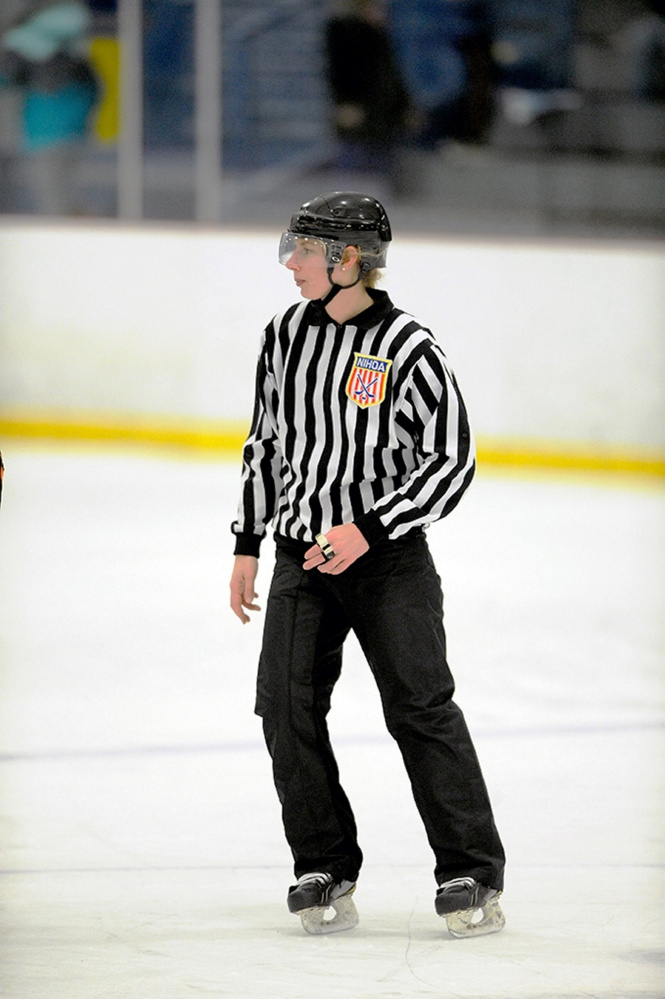 Jessica Leclerc, a Cony High School graduate, works a game at the Biddeford Ice Arena in January 2017. Leclerc will officiate some women's hockey games at the 2018 Olympics.