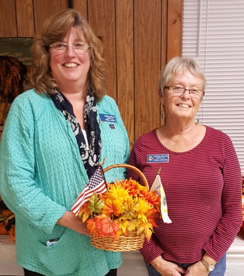 Lion Pam Jewett, left, and Lion Donna Brooks.