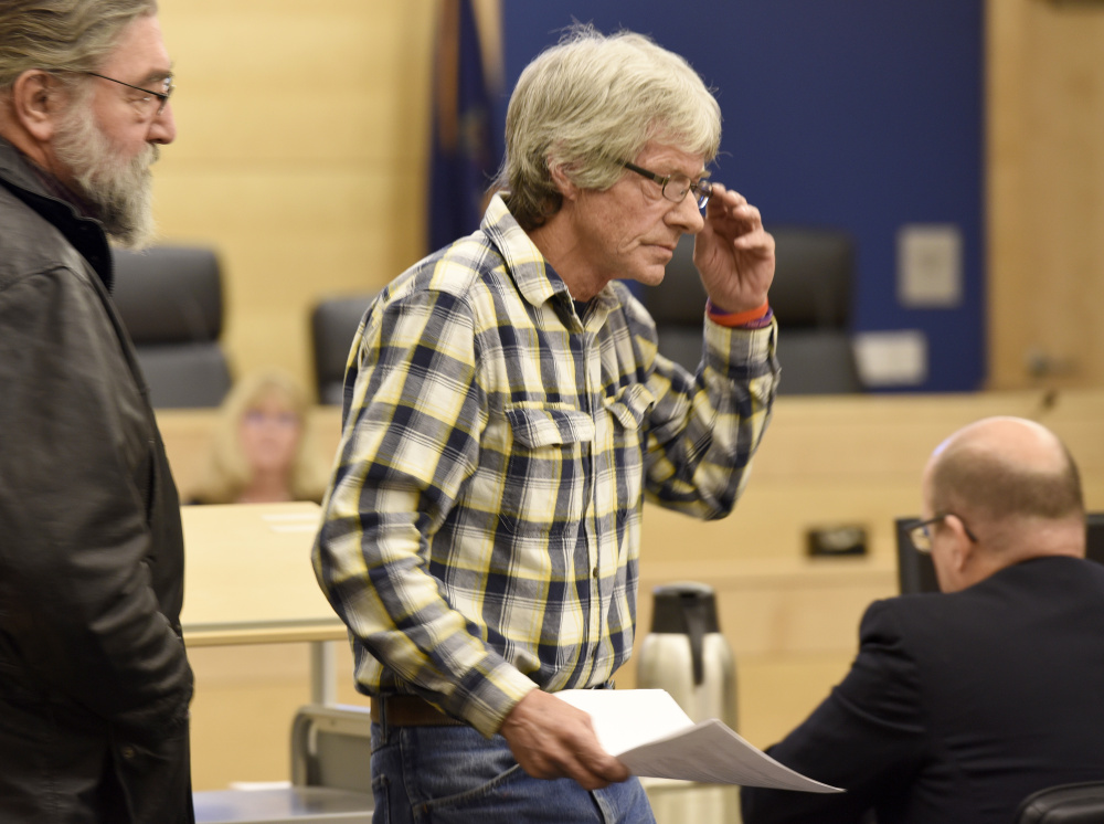Vance Ginn, right, returns to his seat after testifying about his daughter, Stephanie Gebo, at Penobscot Judicial Center on Friday during the sentencing of Robert Burton for the murder of Gebo. Ginn later spoke of the need to use ankle monitoring bracelets to prevent assaults and murders by domestic violence perpetrators like Burton.