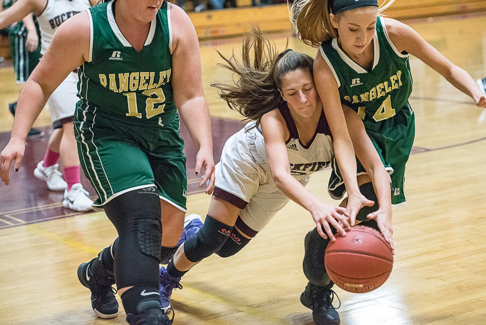Buckfield's Katy Henderson loses control of the ball while Rangeley's Vanessa Bisson and Emily Eastlack scramble to defend during a Class D South game Friday night in Buckfield
