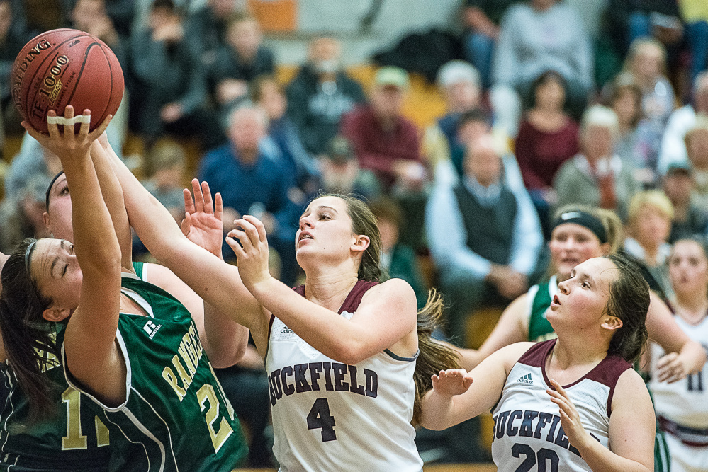 Rangeley's Winnie Larochelle and Buckfield's Caroline Trimm fight for a rebound during a Class D South game Friday night in Buckfield
