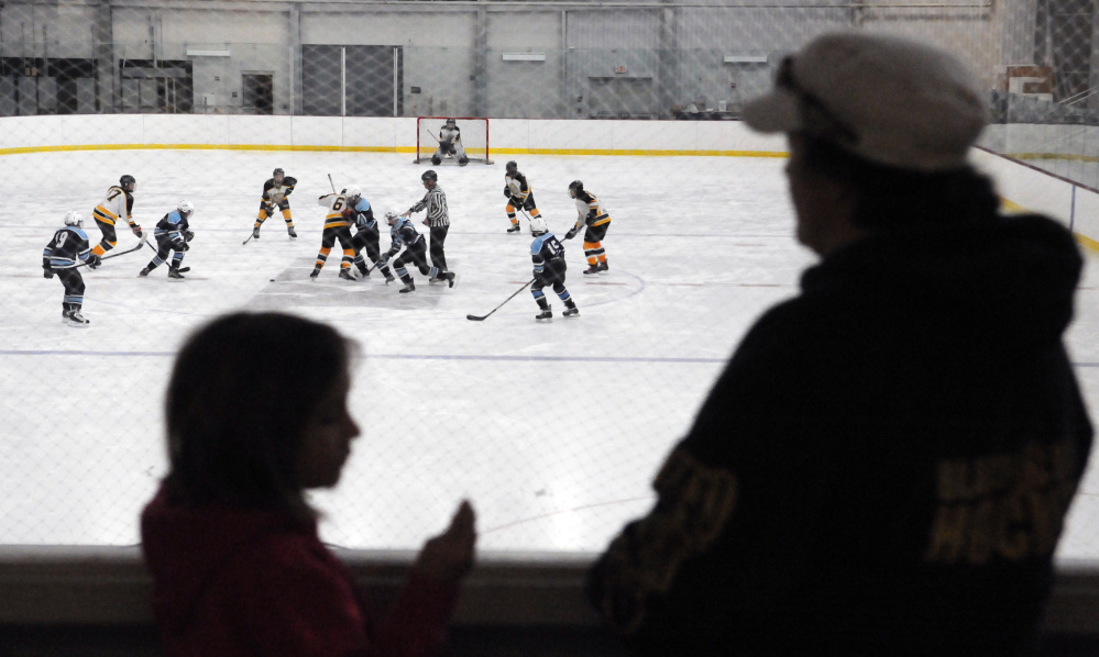 Spectators watch a Marnaook bantams youth hockey game against Presque Isle on Saturday morning at Bonnefond Ice Arena on the Kents Hill School campus.