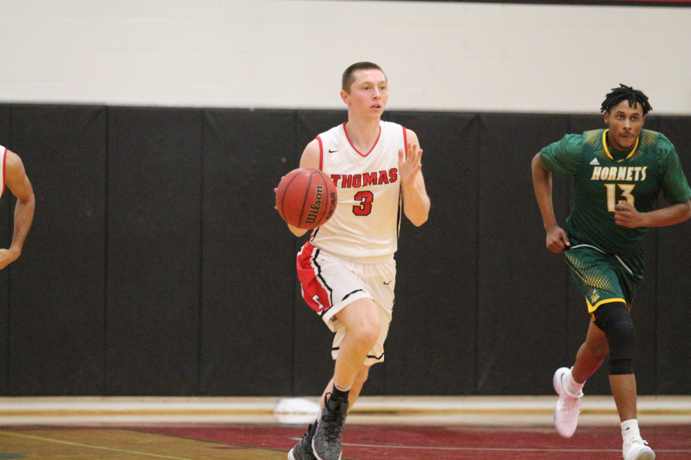 Sophomore guard Zach Mackinnon leads Thomas College with 13.5 points per game.