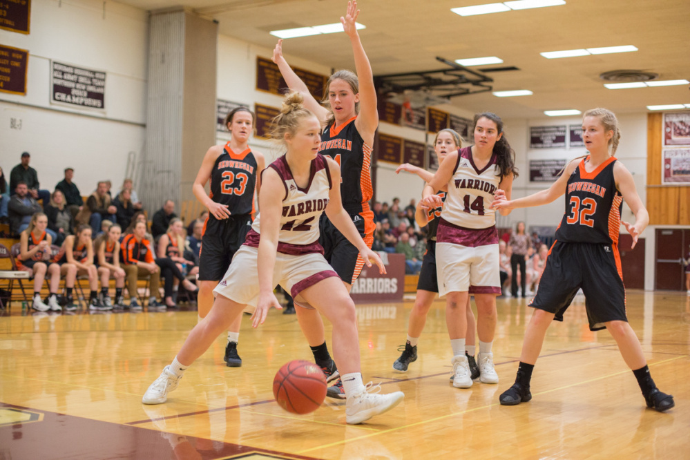 Nokomis freshman Alexys Mayhew, front, looks for an open teammate during a Kennebec Valley Athletic Conference Class A game against Skowhegan on Monday night in Newport.