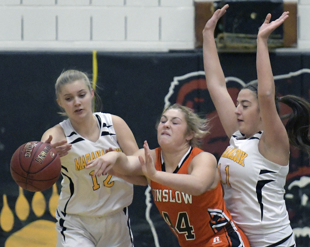 Maranacook's Grace Despres, left, and Amanda Goucher attempt to block a pass by Winslow's Weslee Littlefield during a Kennebec Valley Athletic Conference Class B game Tuesday in Readfield.