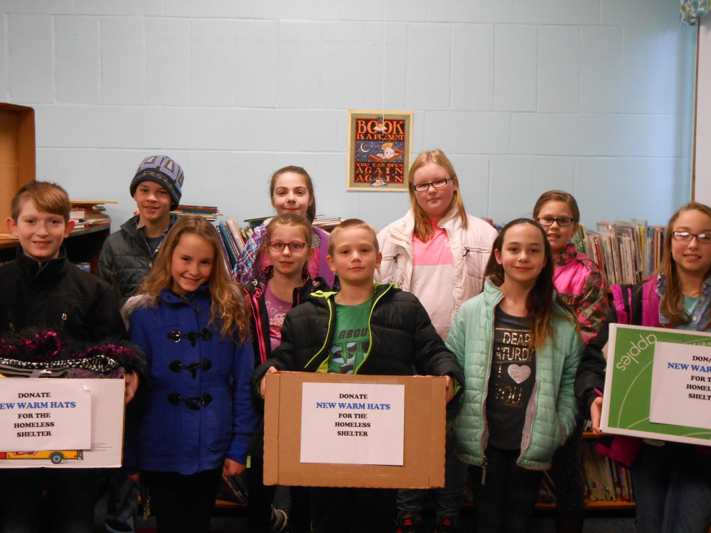 "The Clinton Elementary School Student Council recently led a school-wide drive for warm winter hats, scarves and mittens and or money for the Mid-Maine Homeless Shelter. Its ""Hats for the Homeless"" drive netted $181 and approximately 150 warm winter items. Front, from left, are Colton Carter, Kylie Delile, Natalie Reid, Kaulen Liberty, Jenna Furchak and Layla Gagnon. Back, from left, are Oliver Lang, Candace Day, Alyssa Carter and Kaylie Smith."