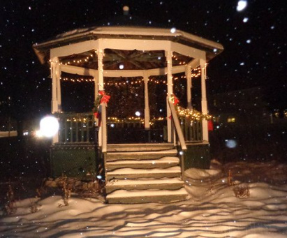 The vintage bandstand on the Village Green between the town office and the school in Jefferson during Monday afternoon's snow storm. For many years, volunteers from the Jefferson Historical Society have decorated the bandstand and supplied a wreath for the Veterans Monument.