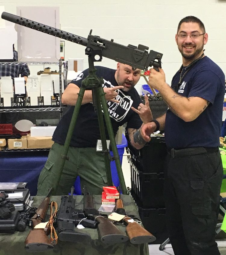 "Ignazio ""Iggy"" Falcone, of Manchester, New Hampshire, poses early this year with a Browning M1919 belt-fed rifle at a gun show in Manchester, New Hampshire. Falcone was arrested Sunday at a gun show in Augusta after allegedly violating a protection order the previous day by handling a shotgun."