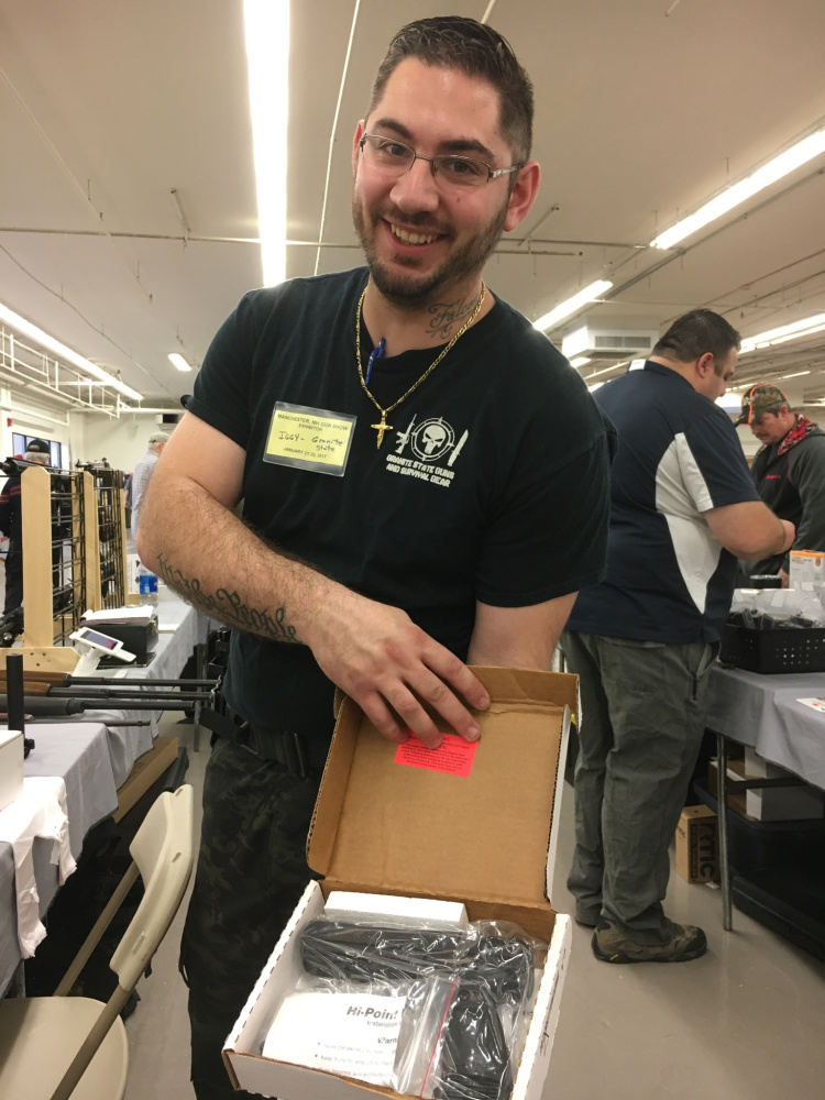 "Ignazio ""Iggy"" Falcone, of Manchester, New Hampshire, displays a handgun in early 2017 at a gun show in Nashua, New Hampshire."