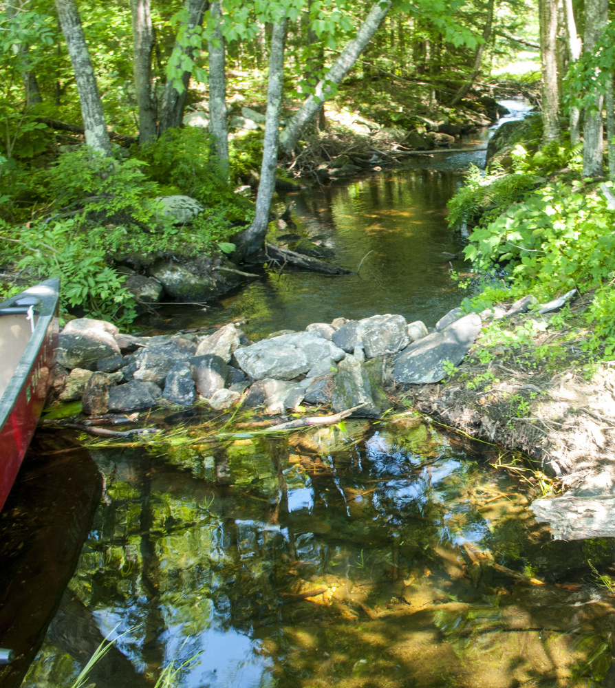 This rock impoundment holds back water Aug. 2 on David Pond in Chesterville.