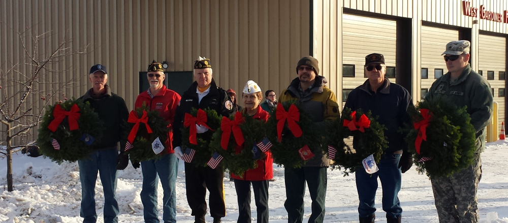 As part of the Wreaths Across America celebration, seven veterans from West Gardiner laid wreaths at the town's Veterans' Memorial on Dec. 16. The wreaths, with flags from all branches of the military services and POW/MIAs, were displayed. Ms. Bryce Smith sang the Star Spangled Banner and Dylan Haskell played Taps. From left are Dan McLaughlin, Greg Couture, Ron Dixon, Deb Couture, Keith Jiminez, Don Goggin and Sgt. 1st Class Michael Boyce.