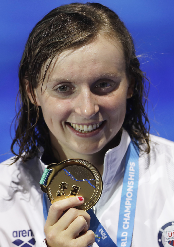 United States' gold medal winner Katie Ledecky shows off her medal after the women's 800-meter freestyle final during the swimming competitions of the World Aquatics Championships in July in Budapest, Hungary.