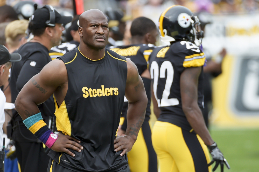 Former Pittsburgh outside linebacker James Harrison walks the sidelines as the Steelers plays against the Jacksonville Jaguars in an October game in Pittsburgh. Harrison was released by Pittsburgh on Saturday and signed with the New England Patriots on Tuesday.