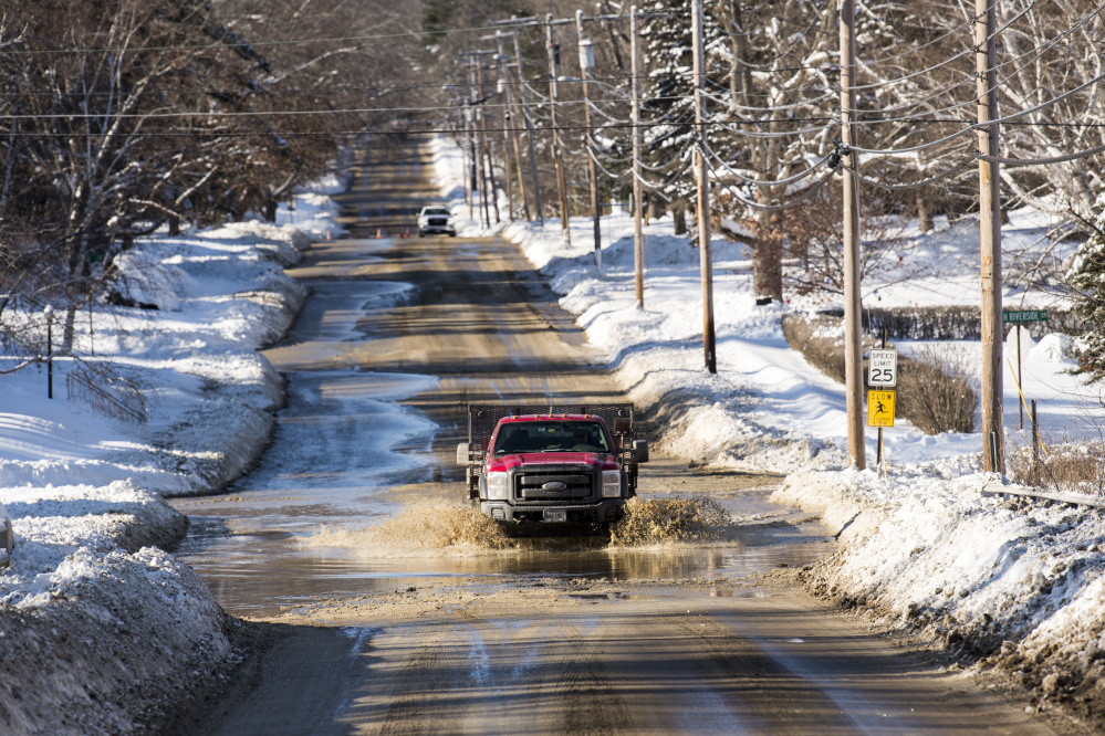 A water main break on Wednesday floods parts of Mayflower Hill Drive in Waterville.
