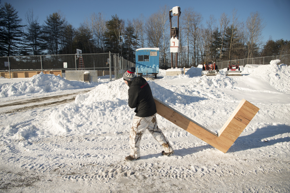 Brent Cook, with the Skowhegan Parks and Recreation Department, prepares the basketball courts for ice Wednesday at the department in Skowhegan.