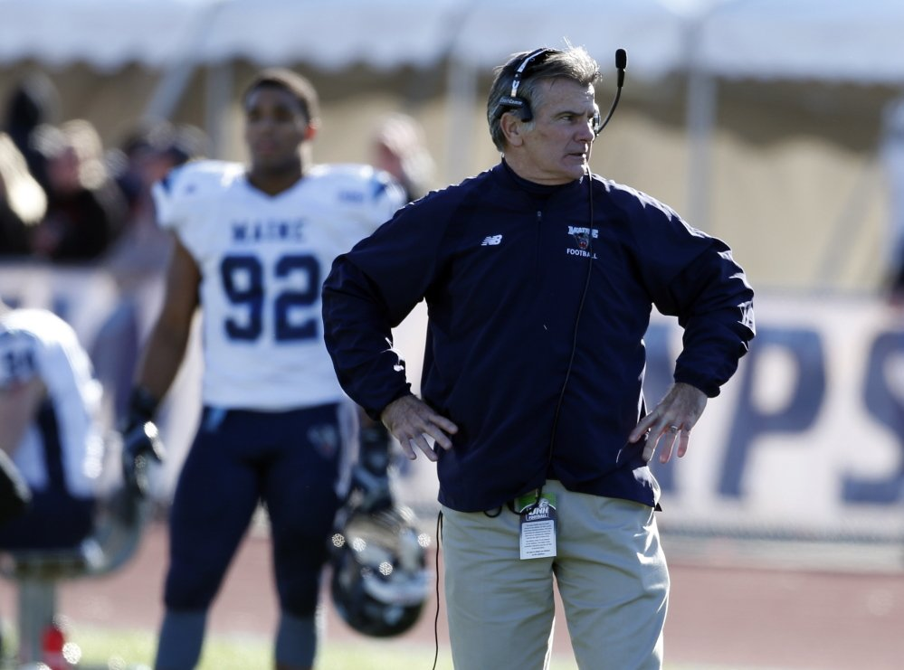 Maine head coach Jack Cosgrove watches from the sidelines during a Nov. 23, 2013, game against New Hampshire in Durham, N.H.