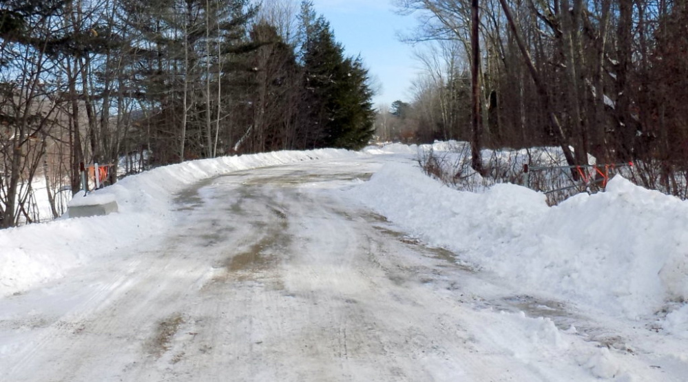 Chesterville selectmen will ask voters to approve discontinuing a portion of Webber Road at the March 12 Town Meeting. At issue is this gate, seen open, which was put up with the approval of a prior board in an effort to limit littering on Chris Osgood's property beyond the gate.
