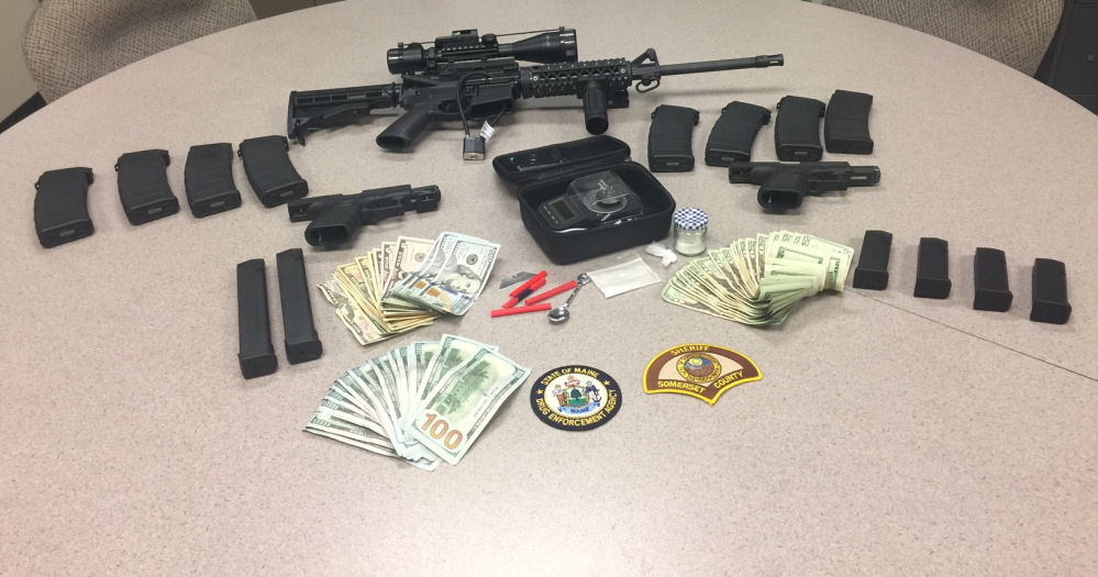 Deputies with the Somerset County Sheriff's Office seized several grams of Fentanyl powder, $2,995 in cash, a digital scale, an AR-15 rifle with multiple magazines, a loaded .40-caliber semi-automatic handgun, a loaded 9 mm semi-automatic handgun, an AR-style .22-caliber rifle, drug paraphernalia and drug-related documentation in a raid Friday in Pittsfield.