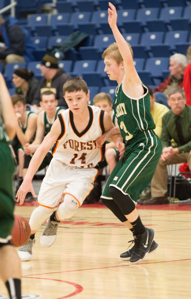 Forest Hills freshman Parker Desjardins (14) dribbles past Rangeley freshman Will Brey during the Capital City Hoop Classic on Friday at the Augusta Civic Center.