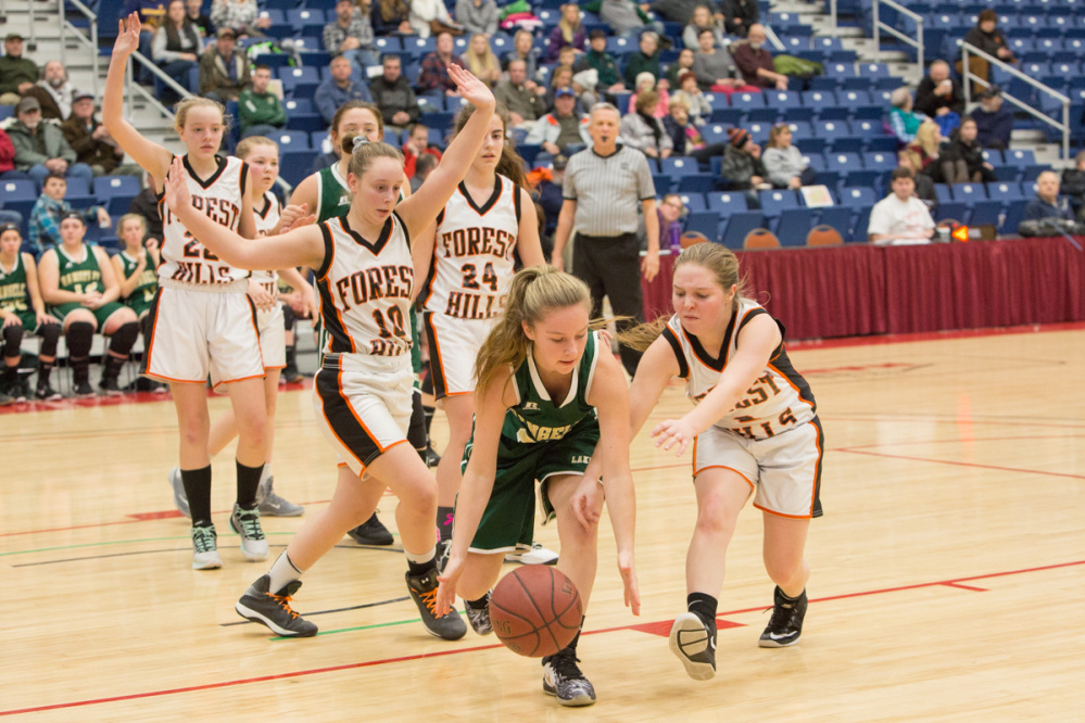 Rangeley's  Amber Morrill, center, goes after a loose ball ahead of Forest Hills  Demitria Giroux, right, and Mary-Lee Brown (10) during the Capital City Hoop Classic on Friday at the Augusta Civic Center.