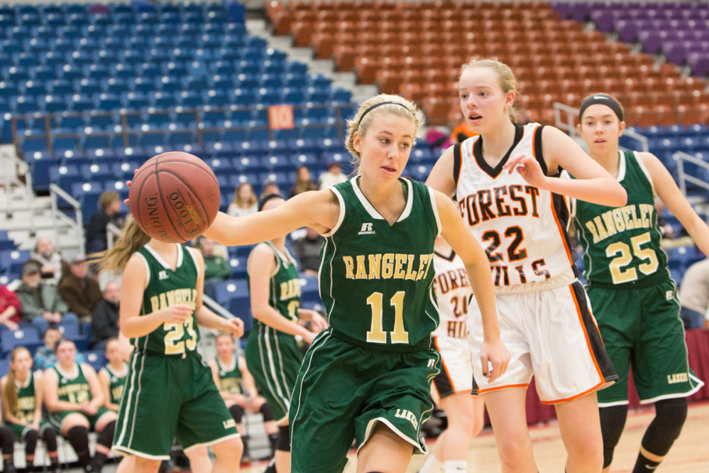 Rangeley's Lauren Eastlack (11) keeps the ball in play while being defended by Forest Hills' Taylor Fountaine (22) during the Capital City Hoop Classic on Friday at the Augusta Civic Center.
