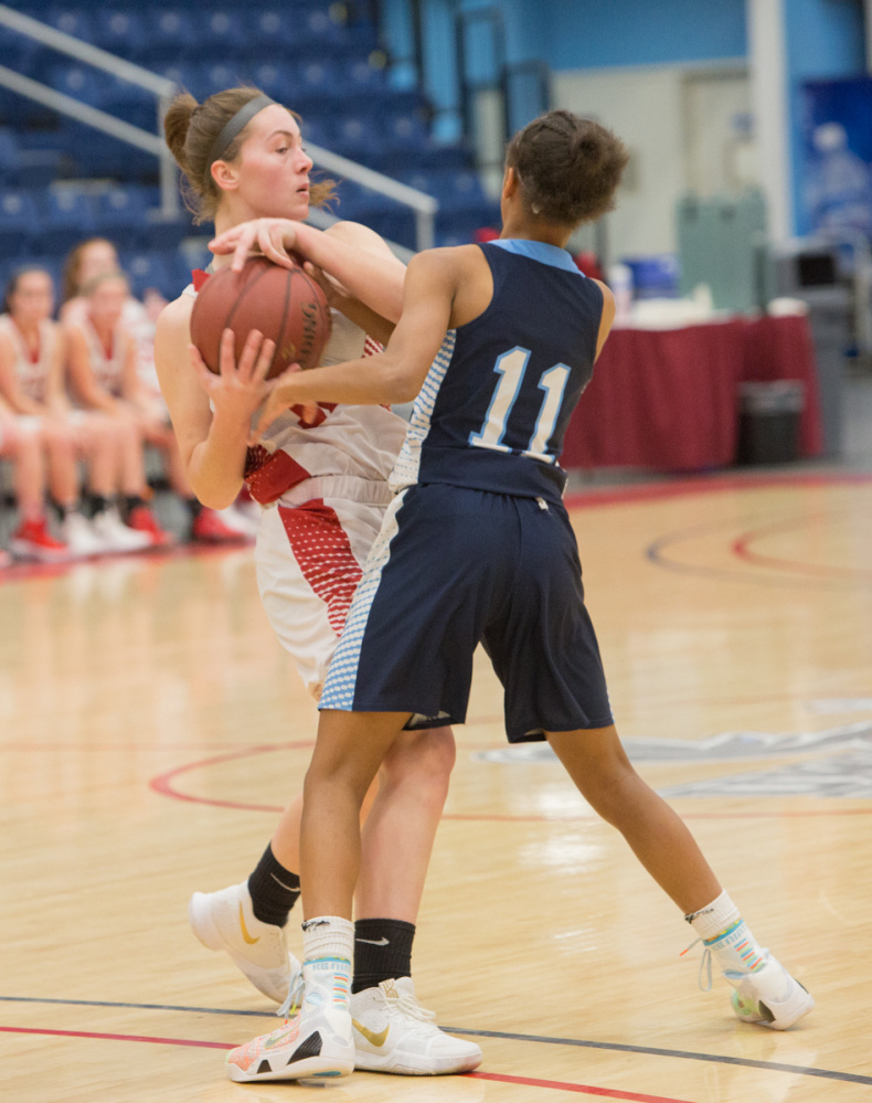 Cony's Carly Lettre, left, defends the ball from Oceanside's Hope Butler (11) during the Capital City Hoop Classic on Friday at the Augusta Civic Center.