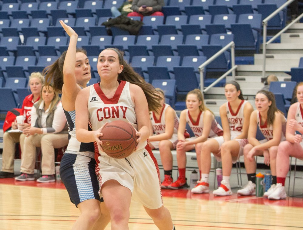 Cony's Sarah Caron looks for an open shot while being defended by Oceanside's Grace Woodman during the Capital City Hoop Classic on Friday at the Augusta Civic Center.
