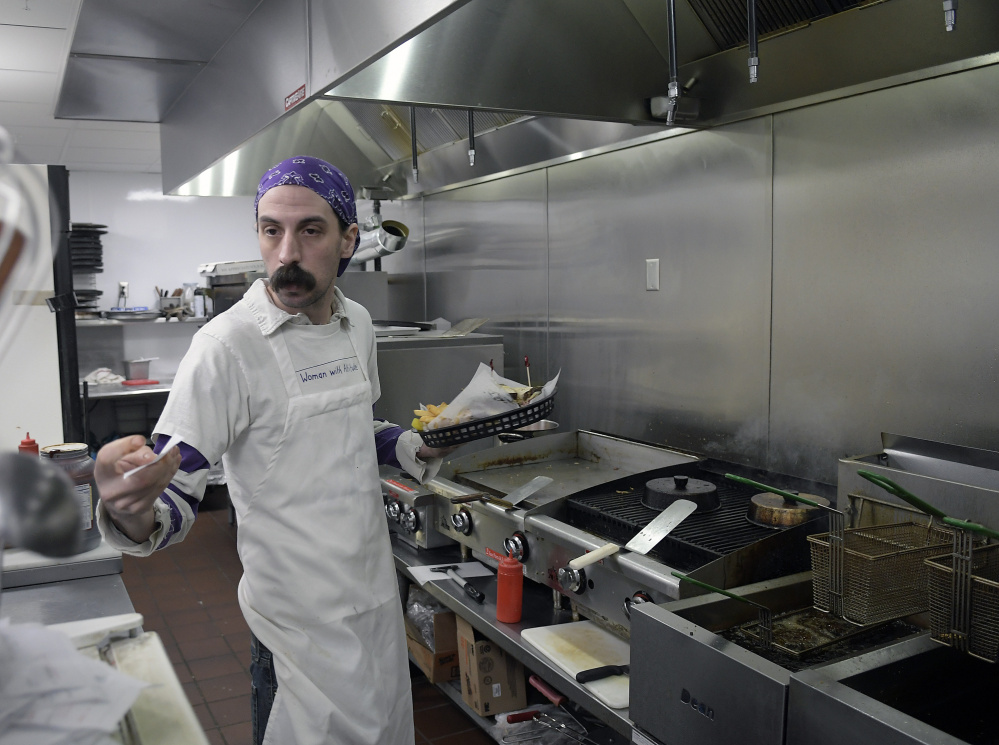 Chef Daniel Muller-Hayes preps food in the new kitchen at the Depot in Gardiner on Dec. 21. The bar and restaurant is completing an expansion.