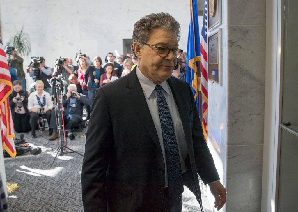 Sen. Al Franken, D-Minn., returns to his office after talking to the media on Capitol Hill on Monday. On Wednesday, multiple colleagues, many of them women, called on him to resign because of allegations of sexual impropriety.