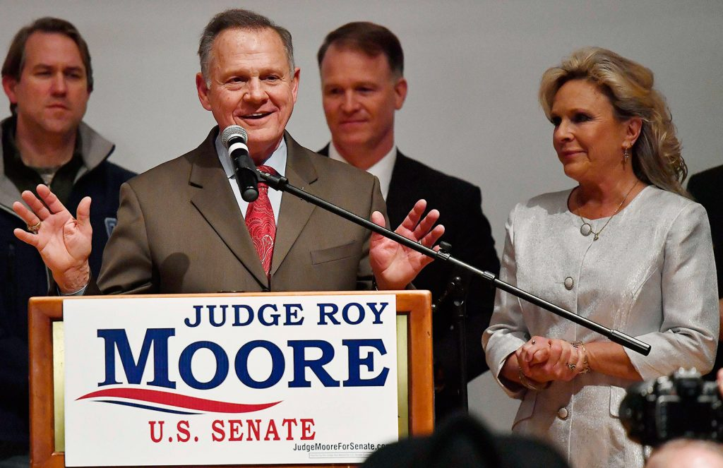 Republican Senate candidate Roy Moore speaks as his wife, Kayla Moore, right, listens Tuesday night in Montgomery, Ala. Moore did not concede to his Democratic opponent, Doug Jones, despite vote totals showing Jones the winner of a close race.