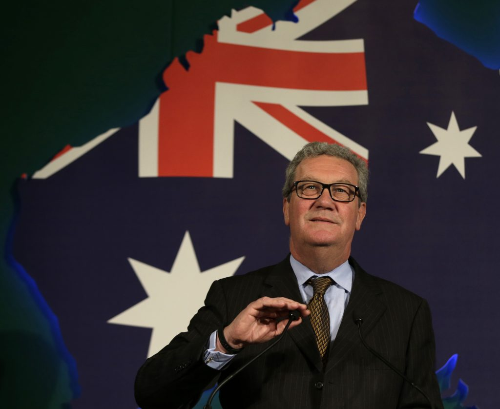 This June 22, 2015, file photo shows Australian High Commissioner Alexander Downer, left, speaking to guests during a welcome party at the Australian High Commission in London. Trump campaign adviser George Papadopoulos told the diplomat, Downer, during a meeting in London in May 2016 that Russia had thousands of emails that would embarrass Democratic candidate Hillary Clinton, the report said. Australia passed the information on to the FBI after the Democratic emails were leaked, according to The New York Times, which cited four current and former U.S. and foreign officials with direct knowledge of the Australians' role.