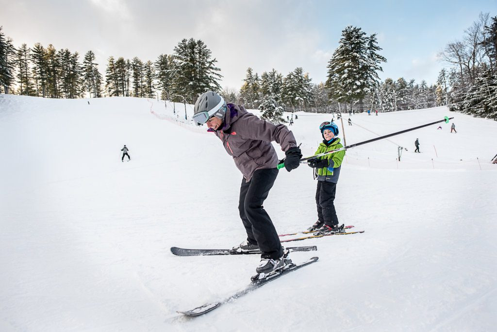 Kristen DeCastro of Falmouth gives her son Tyler a tow Tuesday afternoon after a day of skiing at Lost Valley Ski Area in Auburn. Skiers at Maine mountains will face dangerous cold and wind chills over the next several days.