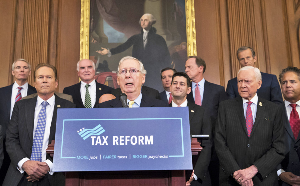 Senate Majority Leader Mitch McConnell, R-Ky., center, and Speaker of the House Paul Ryan, R-Wis., have reached an agreement in principle on a sweeping bill to change American tax law.