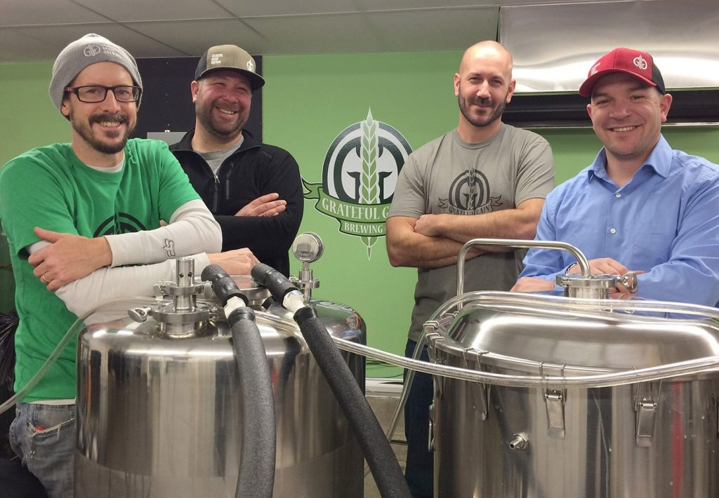 Business partners and friends, from left, Trevor Knell, Ryan Cote, Tom Langlois and Nick Knowlton opened Grateful Grain Brewing Co. in Monmouth this month. They sold out of beer in their first nine hours of business.