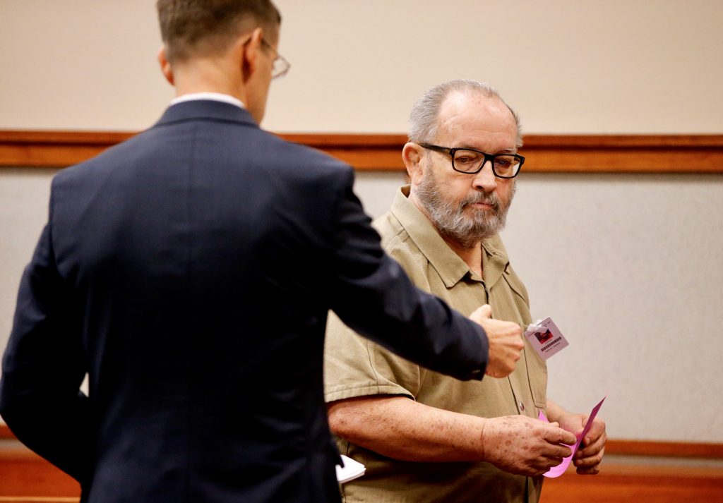 Former Jesuit priest James Francis Talbot confers with defense attorney Walter McKee after pleading not guilty to charges that he sexually abused a 9-year-old boy at a Freeport church nearly 20 years ago.