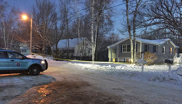 Police on the scene Dec. 20 on Massachusetts Avenue in Millinocket, where a home invasion occurred a day earlier. An arrest in the case was made Thursday.