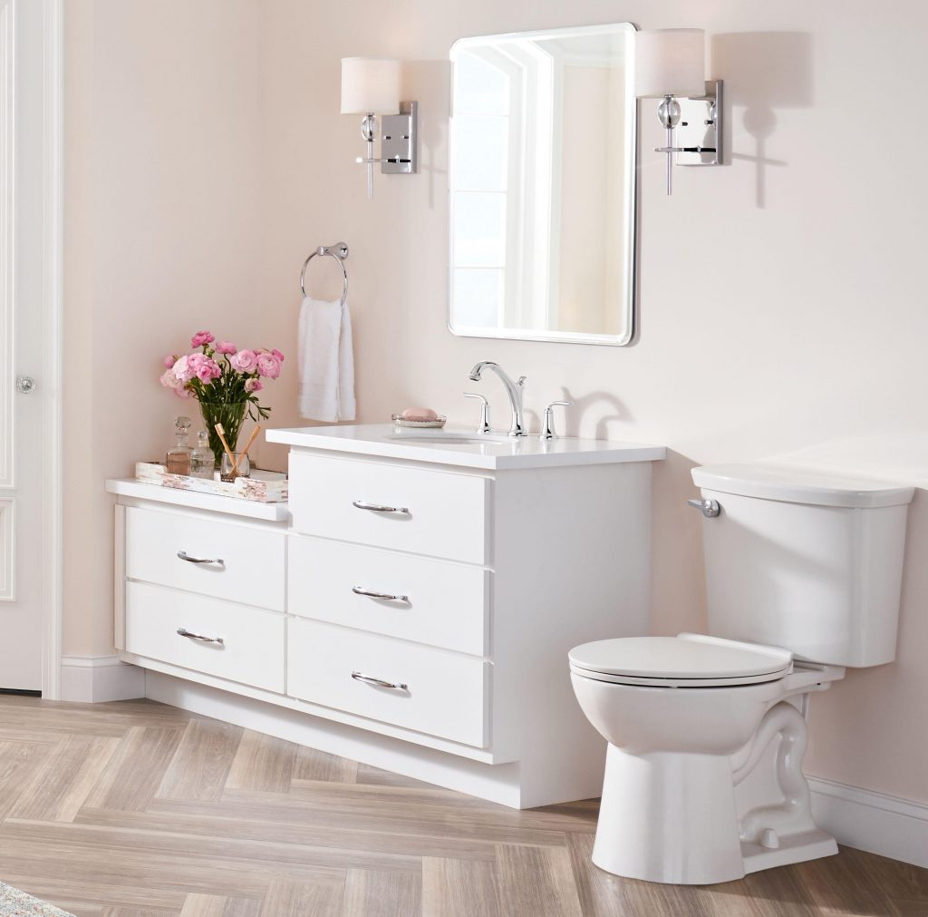 Upgraded sconce lighting, a high-efficiency toilet, and stylish bath faucets from the American Standard Patience collection are key factors in attracting potential home-buyers.