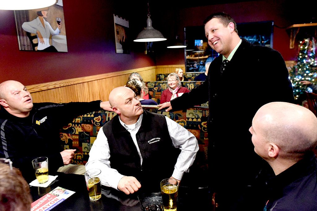 Shane Bouchard, standing, talks to supporters at Marco's Ristorante in Lewiston on Tuesday after the polls closed. Bouchard was elected Lewiston's mayor by a 145-vote margin over Ben Chin.
